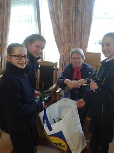 Young Pioneers handing out St Brigid